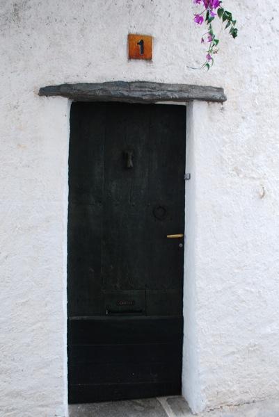Who lives behind the door 1?